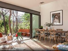 5 minutes to downtown, a modern oasis with warmth and tons of natural light streaming through the skylights and walls of glass, back patio, small stream, serene setting and greenery which creates a privacy and warmth. ...