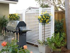 Frame a small patio with a bright lattice grill screen, which enhances privacy and gives a room-like feel to an outdoor space. This screen project uses 4x4-foot posts to serve as an outdoor wall, define patio space and help hide plastic storage bins.