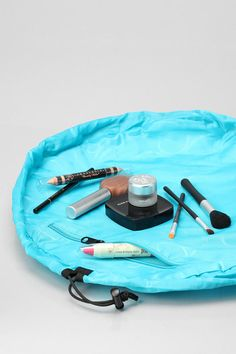 Lay-N-Go Makeup Bag. Maybe make a sewing kit the same as this too with pockets that can sit it a basket or be made into a bag by pulling the drawstring