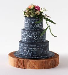 Project Cake rustic chalkboard cake decorated with a wedding reading and topped with fresh blooms