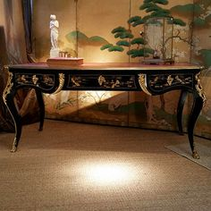 Very fine, French, Louis XV style, black lacquer (chinoiserie) bureauplat: With bronze d'ore mounts and original gilt, embossed leather blotter. Mid-19th century.