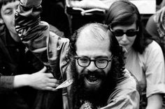 1965: Beat poet and counterculture leader Allen Ginsberg expounds on the flower power concept (the potency of flowers as a visual spectacle) while helping organize a November protest against the Vietnam War in Berkeley, California.