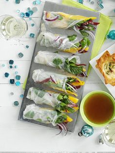 Duck and mango rice paper rolls - Add an Asian twist to your drinks party with our easy recipe for duck and mango rice paper rolls, ready in just half an hour.