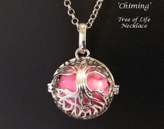 Tree of Life Jewelry, Tree of Life Necklaces | Affordable Quality  Chiming Tree of Life Necklace, Chimes with Movement, Pink Ball [TOLP126] - Beautiful Chiming Tree of Life Necklace featuring a hinged silver cage with a beautiful 'Celtic Tree of Life' design with a Pink Chime Ball producing a soothing chime like sound with movement  #treeoflife #treeoflifenecklace #necklace #treeoflifependant #jewelry #treeoflifejewellery #jewellery #treeoflifejewelry #pendant #celticjewellery #celticjewelry