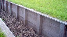 schot met azobe palen als mogelijke oplossing voor helling/talud in tuin