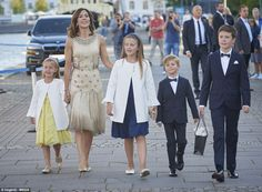 Princess Mary's daughters looked adorable in matching white coats, while her sons were smart in navy suits and dickie bows