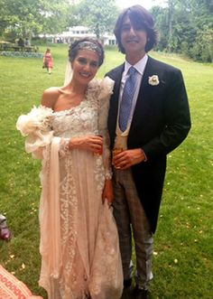 Am I the only one who loves Margherita Missoni's non typical self-designed wedding gown and her husband's mismatched pants? So much hate for both! :(