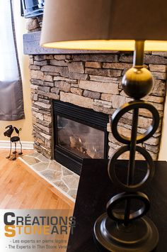 Fireplace done with Cultured Stone Fox Southern Ledgestone.  Sierra Algoma Mats from Realstone Systems for Hearth.
