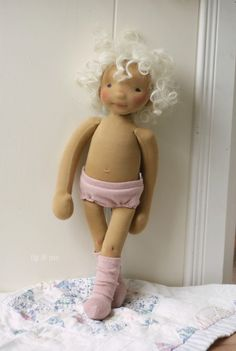 Harriet, a natural fiber art doll by Fig and me, in nothing but her cashmere under clothes.