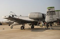 Airmen perform maintenance on an A-10 Thunderbolt prior to its participation in the Max Thunder exercise at Kunsan Air Base, Republic of Korea, Nov. 4, 2013. Max Thunder exercises foster bilateral aerial training between the Korea Air Power Team, which includes the U.S. Air Force, Marine Corps and the Republic of Korea air force. (U.S. Air Force photo by Senior Airman Armando A. Schwier-Morales/Released)