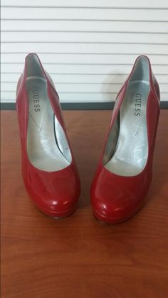 Red patent Guess pumps. Size 8.$20