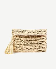 Shop Ann Taylor for effortless style and everyday elegance. Our Foldover Straw Clutch is the perfect piece to add to your closet.