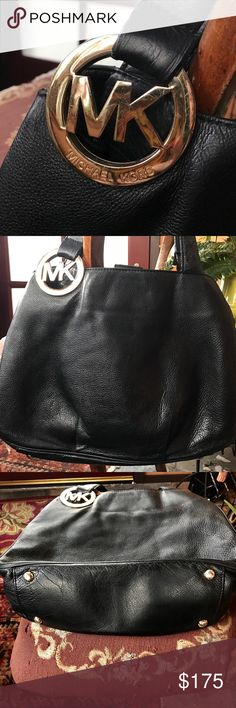 Michael Kors Fulton East West Leather Tote Bag This MK beautiful Leather bag is a buttery soft leather with large MK gold emblem on both sides of purse. Magnetic inside button closure. Lots of big pockets inside with zipper closure. Lovingly Used condition please see photos. Stains inside and hardware scratches. Michael Kors Bags Shoulder Bags