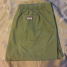 Cherokee workwear scrub pants, small Elastic band in back with tie in front. Waist measures 16 inches with inseam measuring 30 inches. Pretty Olive color. Has the two side pockets and one in back. Has the 3 inch splint on bottom of pants, see last picture. In great condition with no holes or stains. Any questions please let me know. Cherokee Pants