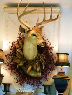 Deer head decorated with a wreath. I don't like this exact wreath but love the idea.