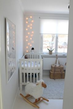 No more scary darkness: Hanging string lights like this above crib is a great idea for the nursery.