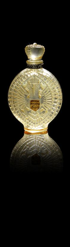 Rene Lalique for Khouri 'Vieille Russie' a Perfume Bottle and Stopper, design 1936 frosted and polished glass 8.5cm high, moulded 'R.LALIQUE FRANCE'