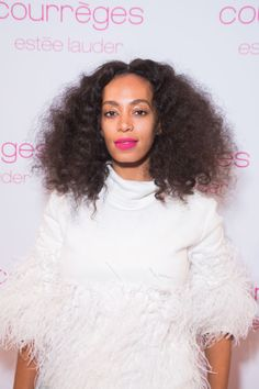 To get Solange's nebulous curls, braid wet hair and let it dry overnight. Undo in the morning and style as desired. And don't forget to #embracethefrizz.