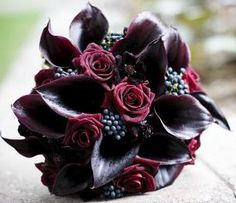 deep purple calla-lilly flowers are my favorite...Would incorporate with white lilies