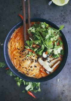 Thai Red Curry Noodle Soup w/ broccoli & mushrooms. Aka The best thing ever/life changing- recipe edits: use regular mushrooms, add tofu, add more coconut cream than recipe calls for.