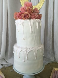 Double barrel two tier drip cake made with Wilton candy melts,  fondant, fresh cinnamon and harmony roses.