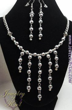 Check out this item in my Etsy shop https://www.etsy.com/listing/561097339/gray-and-silver-earrings-and-necklace