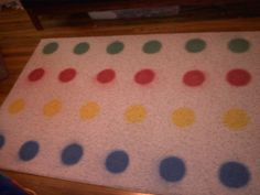"""I made my own Twister rug for my """"Kids Room"""" in my house.  Just got a 4x6 white rug, and spray-painted circles on.  The kids love it, especially because it's a little smaller than the game board so their little legs can reach.  And, it doesn't slip like the game board does!"""