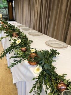 We love this type of Top Table floral arrangement. A lovely garland of foliage with scattered flowers, candles and seasonal ornament. Thanks to for these pictures from the wedding open day with Top Table Flowers, Opening Day, Floral Arrangements, Garland, Wedding Flowers, Tables, Seasons, Table Decorations, Ornaments