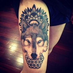 A wolf wears a mandala design as a spiritual crown in this decorative animal totem tattoo. [source]