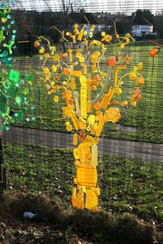 Rainbow Trees From Up-cycled Plastics Recycled Art Recycled Plastic Rainbow Trees From Up-cycled Plastics Recycled Art Recycled Plastic Fence Weaving, Theme Nature, Recycled Art Projects, Recycled Materials, Plastic Art, Plastic Bottles, Plastic Recycling, Yellow Tree, Sensory Garden