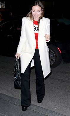 The actress showed off her classically chic style in a Bella Freud jumper, flared jeans and a tailored coat.