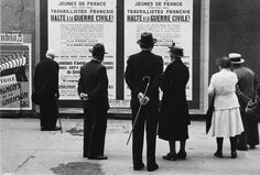 Rudy Burckhardt. People Looking at Political Posters on Street, Paris 1934