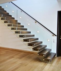 Invisible stringer floating stairs with a glass railing standoff pin system. by Stairs & Railing System Cantilever Stairs, Modern Stair Railing, Stair Railing Design, Staircase Railings, Modern Stairs, Glass Handrail, Glass Stairs, Home Stairs Design, Interior Stairs