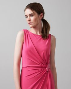 A slinky jersey dress with a beautiful side ruche and train detail. Perfect for bridesmaids, the dress features an embellished detail at the side waist, ruching at the shoulders and a full lining. Complete with a side zip fastening.