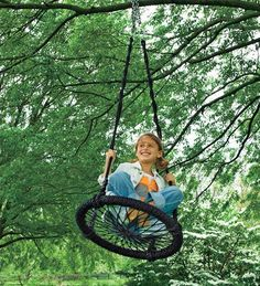 Old school outdoor tree swing. How fun does that look?