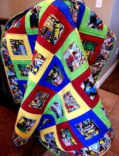 Superhero Quilt Measures 57 x 57 Throw size  $100.00 or Custom Twin size Measures 70 x 90 $125.00  Beautiful Quilt! This would make a wonderful gift for any comic book fan!  With warm and natural batting between the layers, I machine quilted and finish with a traditional hand stitched binding around the edges.