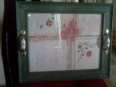 Large picture frame arranged with old handkerchieves with door handle added for a shabby chic tray.