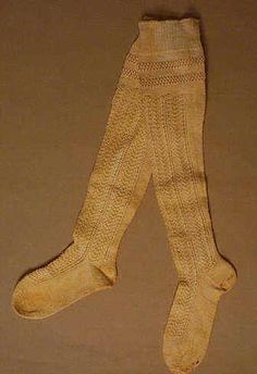 "Child's Stockings, American, c19th century; Medium gauge off-white cotton yarn.  Measurements: Foot 7"", toe-top 20"""