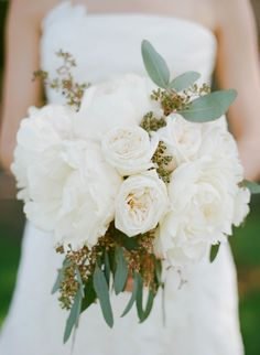 All White Peony Bouquet. See the wedding on SMP: http://www.StyleMePretty.com/2014/01/29/california-wedding-at-santa-lucia-preserve/ Photography: Sylvie Gil | Bouquet: Hunt Littlefield