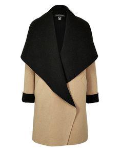 tan and black coat w/ an incredible collar