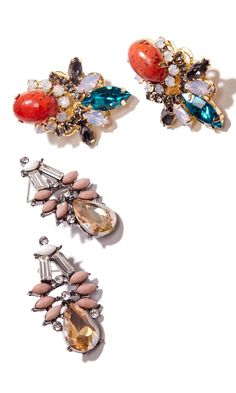 Statement earrings with clusters of glass stones and in 14k gold plated brass.