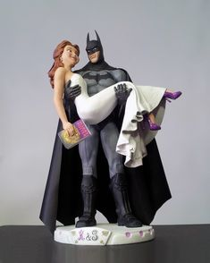 Batman Arkham Disney Belle Custom Wedding Cake Topper by Sophie Cartier Sculpture. Custom concept completed with a Harry Potter book in the bride's hand.