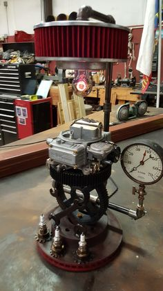 I used a Holley 650 cfm carburetor for the main piece. Light also shines through the air filter. This fixture weighs about fifty pounds. Car Part Furniture, Automotive Furniture, Automotive Decor, Metal Projects, Welding Projects, Metal Crafts, Industrial Style Lamps, Industrial Furniture, Lampe Steampunk