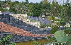 Here is a Gabion retaining wall that doubles as art with the different colors of stone