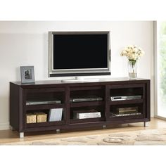 @Overstock.com.com - Pacini Dark Brown TV Cabinet - Modernize your entertainment area with this dark brown TV cabinet. Featuring three tempered glass sliding doors, an engineered wood frame, and rear cable holes for easy management, this TV cabinet is built for both style and convenience.  http://www.overstock.com/Home-Garden/Pacini-Dark-Brown-TV-Cabinet/6975525/product.html?CID=214117 $249.32