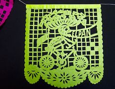 skeleton biker on lime green hand-cut papel picado banner