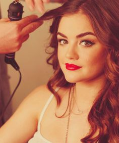 My favorite newcomer Lucy Hale from Pretty Little Liars- Love her strong eyebrows, fierce cat eyes, and cherry red lips.