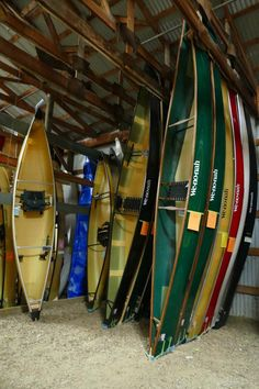 Canoes of different sizes and colors in storage at Wenonah Canoe Small Canoe, Small Boats, Canoe Trip, Canoe And Kayak, Canoe Storage, Garage Storage, Utility Boat, Cabin Cruiser, Canoes
