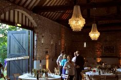 Barn wedding chandeliers over the dining area for rustic glamour