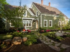 Durable fiber cement clapboards, siding and trim boards, chosen by online voters, replace the home's original wooden lap siding. Lush landscape beds, planted with native species, offer a measured dose of curb appeal.